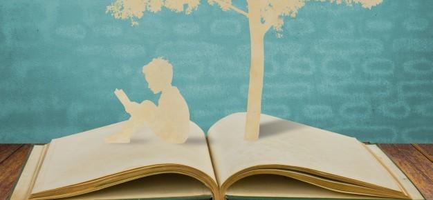 sagome-di-un-albero-e-un-uomo-su-un-libro_1232-292